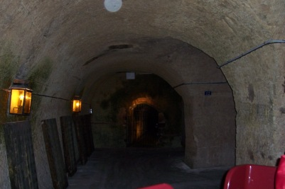 After riding down in an elevator to the subterranean champagne cellars, you take the tour on a little red train, passing hallways filled with champagne.