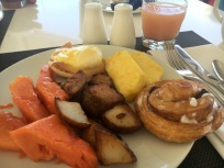 Papaya, Roasted Potatoes, Pineapple, Cinnamon Roll & Eggs Benedict