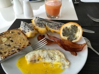 Eggs, Raisin Toast, Dragon and Passion Fruit, Bacon and Pink Grapefruit Juice